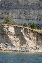 """Постер, картина, фотообои """"rock cliffs along a lake"""""""