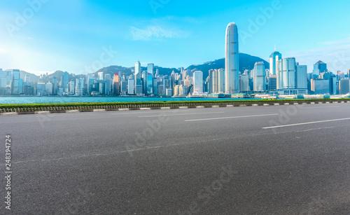 fototapeta na ścianę Road and skyline of modern urban architecture in Hong Kong..