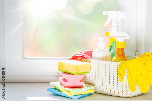 Foto Murales Spring cleaning concept - cleaning products, gloves, bokeh background, copy space