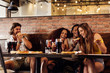 Group of friends having pizza at restaurant - 248430141