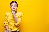 Woman show a quiet sign isolated over yellow background - 248430516