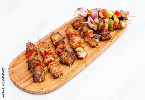 Assorted delicious grilled meat with vegetable on wooden platter. - 248434313