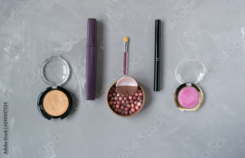 A set of cosmetics for the face in pink - 248447534