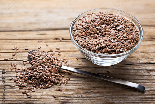 Flax seeds on wooden background