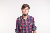People, emotions and gesture concept - young surprised bearded man on white background - 248460329