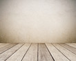 Empty brown cement wall and vintage wooden floor room in perspective view, grunge background, interior design, product display montage, vintage style