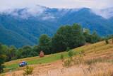 Off-road minivan traveling at the mountain road, Carpathians, Ukraine