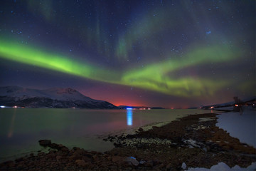Northern lights in the sky over Tromso city, Norway