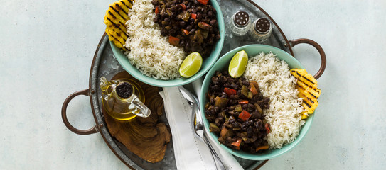 banner of Cuban rice and black bean dish with grilled pineapple. Healthy Vegan Caribbean food for the whole family, party or restaurant menu © irinagrigorii