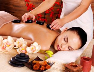 Adult woman having hot stone massage in spa salon © Valua Vitaly