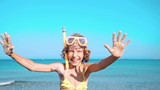 Happy child playing on the beach. Summer vacations concept - 248491573