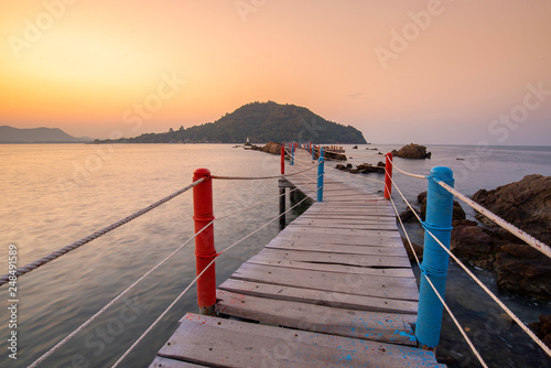 Beautiful amazing nature background. Tropical blue sun sea. Luxury holiday resort. Island about coral reef. Fresh freedom. Adventure day. Snorkeling. Coconut paradise. Wooden bridge. In the twilight. © Aniroot