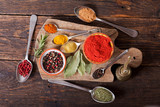 various herbs and spices for cooking on wooden board - 248491909
