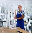 Workman in blue overalls demonstrating pvc window