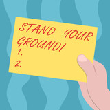 Conceptual hand writing showing Stand Your Ground. Business photo text maintain ones position typically in face of opposition Drawn Hu analysis Hand Holding Blank Color Paper Cardboard - 248496562