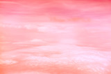 Living Coral color of the Year 2019. Aerial view of sky with fluffy clouds. Retro toned abstract background. - 248499134