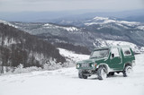 Jeep in mountain in winter