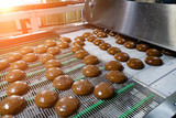 Baking production line. Cookies after glaze coating - 248530383