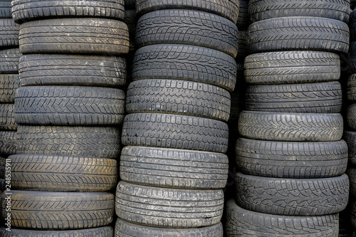old used car tyres, stacked at car service