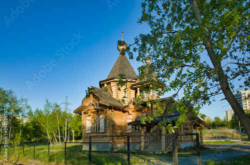 MOSCOW, RUSSIA - MAY 10, 2018: Brateevsky cascade park on the bank of the Moscow River. Wooden church by the pond