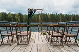Wedding arch decorations on lake, outdoors - 248547507