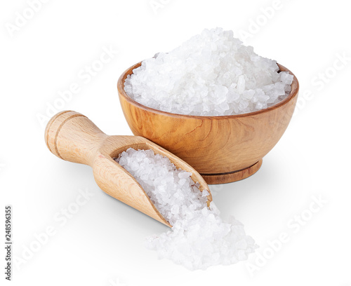 Leinwandbild Motiv Sea salt crystals in a wooden bowl isolated on white