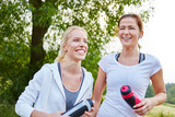 Two sporty women laughing - 248601765