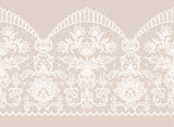 Horizontally seamless beige background and white lace ribbon with floral pattern