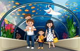 A family at sea aquarium - 248634370