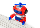 Toy robot and computer - 248644585