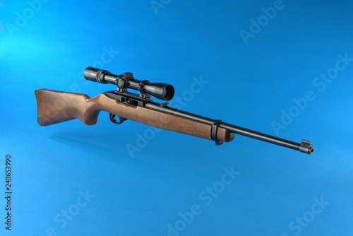 rifle with scope © Mark