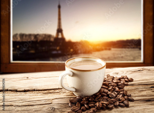 Hot coffee on window sill and Paris landscape  © magdal3na