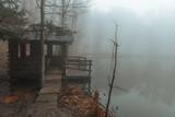 gazebo on a lake in a misty forest - 248675360