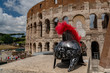 metallic gladiator helm on rome coliseum background