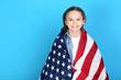 Young girl with American flag on blue background