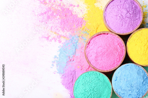 Foto Murales Colorful holi powder in bowls on white background