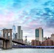 Brooklyn Bridge and Lower Manhattan skyline at dusk