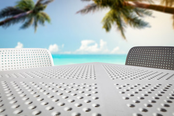 White table of free space for your decoration and sea landscape with two palms.