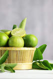 Fresh limes on white wooden background. Green limes.