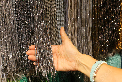 woman chooses the necklaces in the costume jewelry shop © ChiccoDodiFC