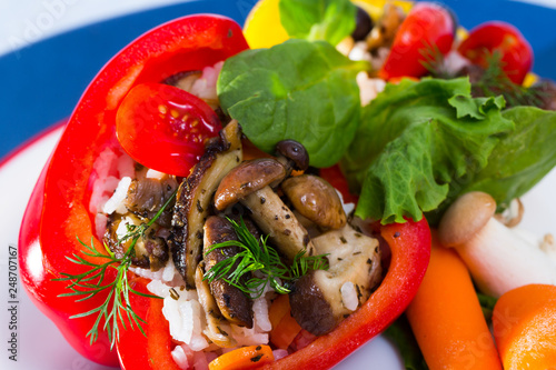 Peppers filled with porcini mushrooms, rice, tomatoes - 248707167
