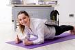 Leinwandbild Motiv Female employee doing sport exercises in the office