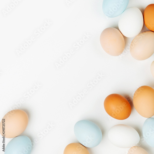 Natural Colored brown and white Eggs on light background. Compositions in pastel colors. Easter consept.  Flat lay, top view © igishevamaria