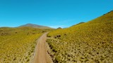Close in on road through valley of mountains high peaks and glaciers near San Pedro de Atacama desert in the north of Chile.