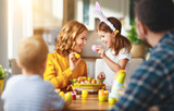 Happy easter! family mother, father and children paint eggs for   holiday - 248753906
