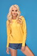 Blonde girl in yellow sweater.