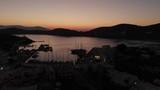 Aerial footage of greek seaport at twilight