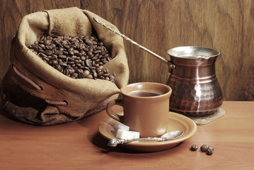Coffee set. A cup of coffee, coffee grinder, coffee Turk, coffee beans, a bag of coffee beans