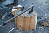 Small and large axes stuck in stump - 248804796