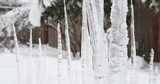 Snowing on frozen icicles in a winter storm - 248806952